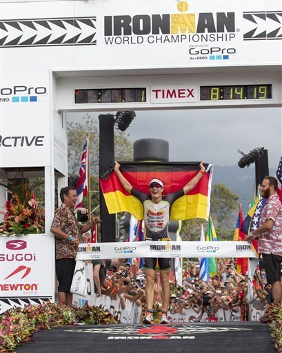 Sebastian Kienle, of Germany, wins the men's 2014 IRONMAN World Championship on Saturday, October 11 in Kailua Kona, Hawaii. Photo: IRONMAN / Marco Garcia / AP Photo Read more here: http://www.newsobserver.com/2014/10/11/4226444_germanys-kienle-wins-ironman-world.html?rh=1#storylink=cpy