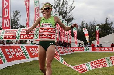 Irvette van Zyl crosses the finish line to win the SPAR Women's Challenge at Kings Park in Durban. Photo: Reg Caldecott