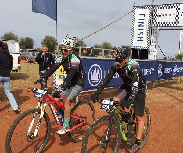 SST-Clotan's Devan Kruger (left) and Gertjie Harmse finish a stage in the inaugural Liberty Waterberg MTB Encounter race. Photo: Supplied