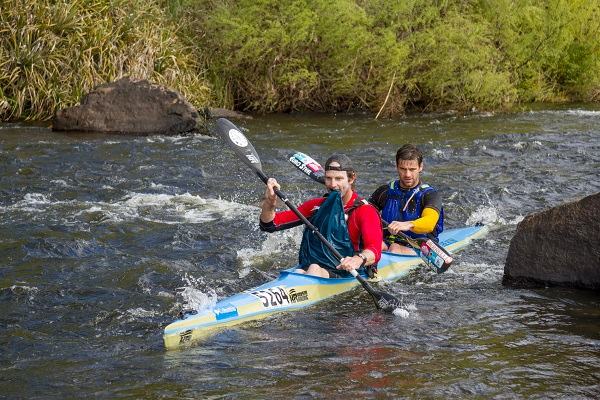 Graeme Solomon (left) and Greg Louw start paddling after portaging Sliding Weir on the first stage of the Breede River Canoe Marathon on Saturday. Photo: Kassie Karstens