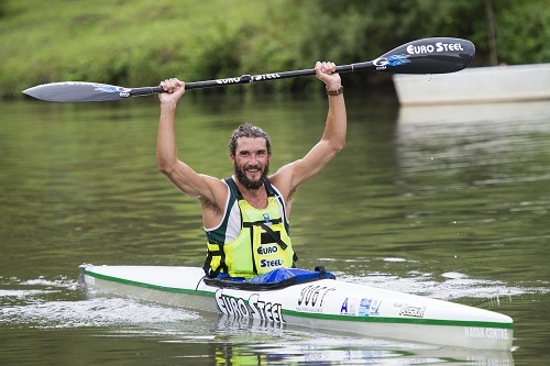 Andy Birkett (Euro Steel) celebrates his third successive win in the 2016 Drak Challenge Canoe Marathon. Photo: Anthony Grote
