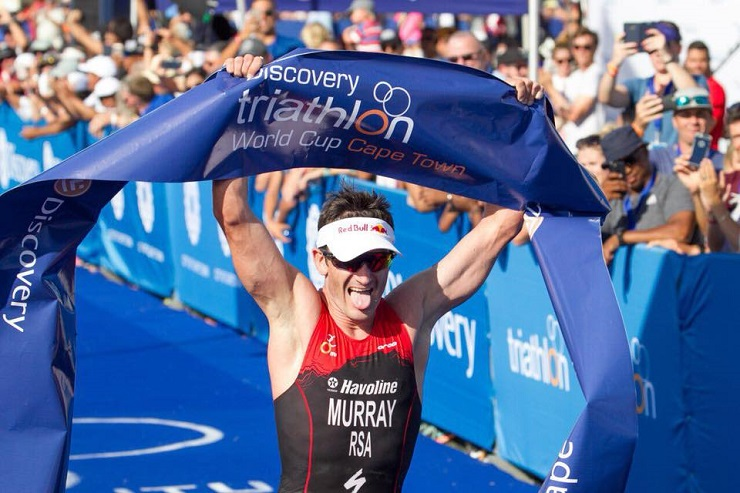 A photo of Richard Murray celebrating after he won the 2018 Triathlon World Cup in Cape Town.