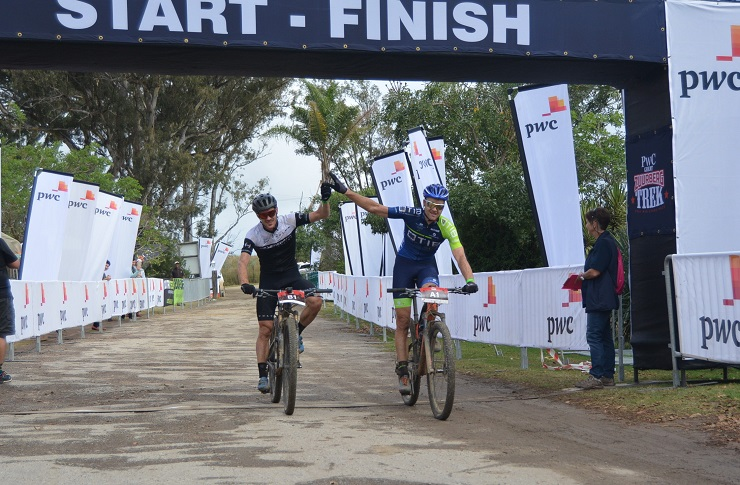 Shaun-Nick Bester (left) and Andrew Hill cross the finish line first at the Zuurberg Mountain Village