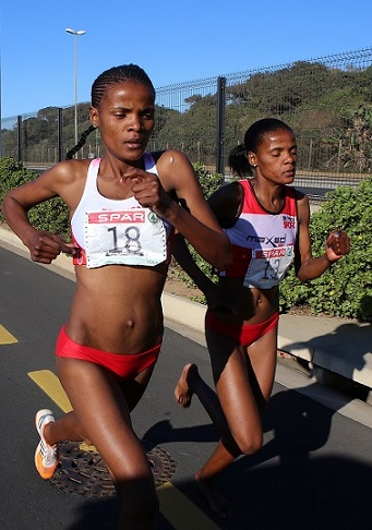 Lebogang Phalula (left) leading the field with her twin sister Diana Lebo-Phalula (right). She went on to win the third leg of the SPAR Women's 10km Challenge series, at Sahara Stadium, Kingsmead on August 24 in Durban. Photo: Reg Caldecott