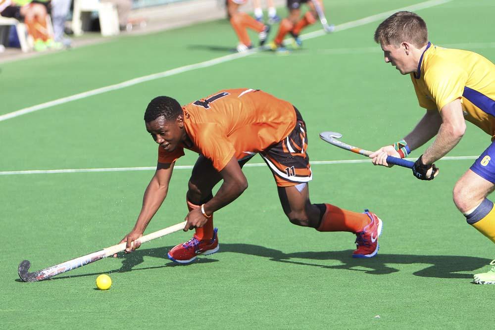 UJ's Amkelwe Letuka fights to gain ground during the Varsity Hockey tournament in Stellenbosch last weekend. Photo: Saspa