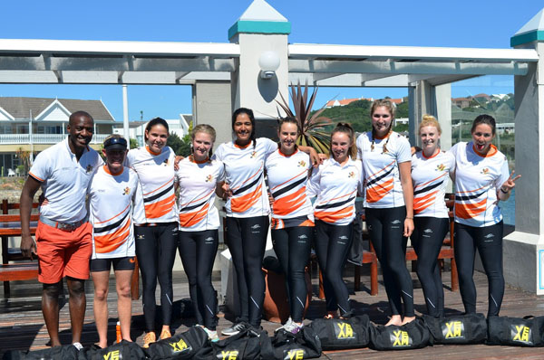 The women's eight who won the Universities Boat Race are (from left) Sizwe Lawrence Ndlovu (coach), Robin Welch (cox), Jacinta de Almeida (captain), Kirsten Nolan, Karena Naidu, Liezl Scholtz, Reid Hefer, Kendra Szeles, Kerry Gough and Danny Borges. Photo: Supplied