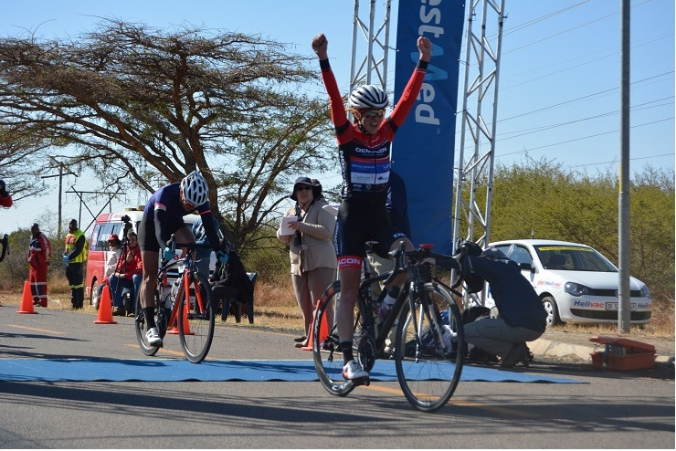 Demacon's Carla Oberholzer celebrates her maiden win in the 103km road race at the Bestmed Cycle4Cansa Championship at Sun City on Sunday.