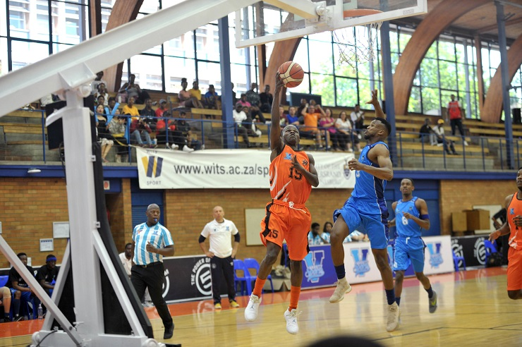 University of Johannesburg's Lance Chikore (left) shoots for goal during their Varsity Basketball