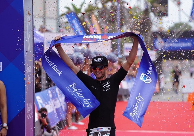 Men's winner Bradley Weiss pictured crossing the finish line at the Ironman 70.3 triathlon in East London today. Photo: Twitter/@IMSouthAfrica