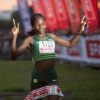 Helalia Johannes crosses the finish line during the SPAR Women's Challenge in Green Point, Cape Town