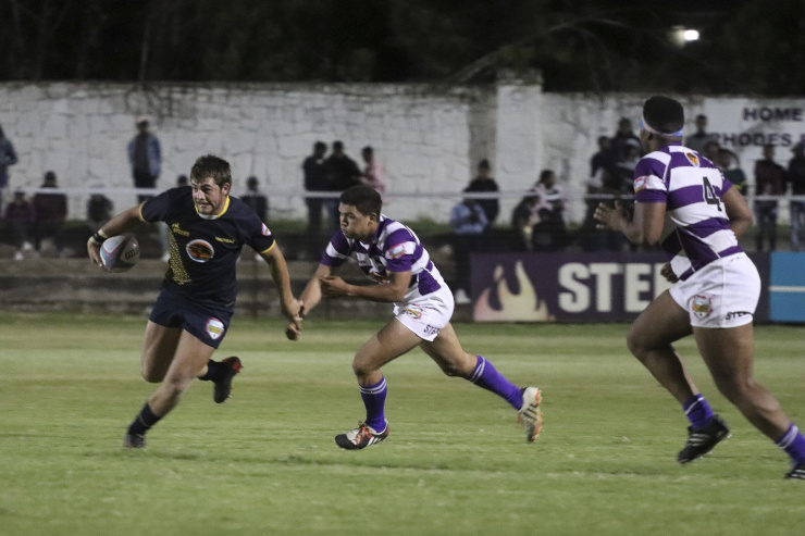 FNB Madibaz centre Johan Lombard goes on a run against Rhodes in their Varsity Shield rugby match